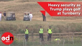 Under heavy security Trump plays golf at Turnberry