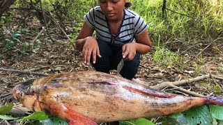 Amazing girl grilling fish in wild - eating delicious marble goby fish