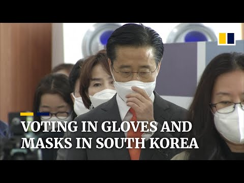South Koreans don face masks, plastic gloves to vote amid Covid-19 crisis