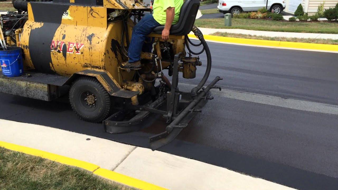 Liquid Road Bituminous Surface Treatment at the Gunston Cove HOA in Lorton,  VA