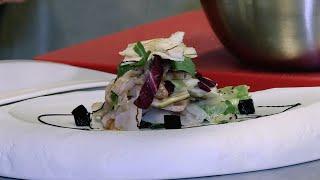 Millefoglie di spigola al foie gras e carciofi con insalatina e gelée di aceto balsamico.