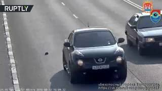 Russian CCTV Man Saves Kitten Stranded In The Middle Of Busy Highway