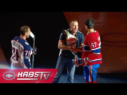 Georges St-Pierre drops ceremonial first puck