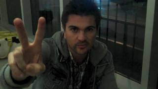 Juanes signing P.A.R.C.E. Calendars for the Juanes.net Store