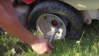How to change tire on lawn mower ( and how many horses and goats u need for that ??? )