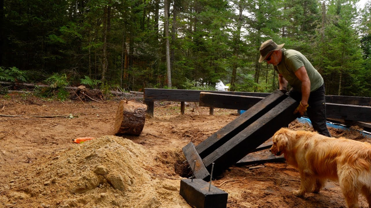 Building a Timber Frame Wood Foundation for a Log Cabin in a Severe Thunderstorm | OFF GRID