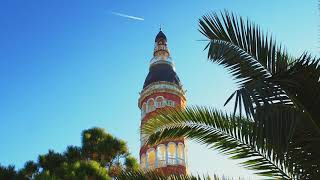 Tower against the blue sky and palm trees. Free stock video. footage Free. Rec.709 1080p 60fps #1