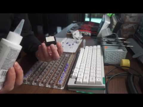Lubing springs of Zealios v2 switches using an ink pad (sponge)