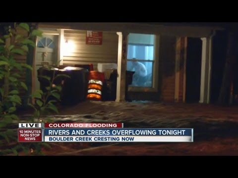 Water overflowing into Boulder homes