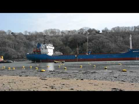 Cargo Vessel Being Towed Into Fowey Docks