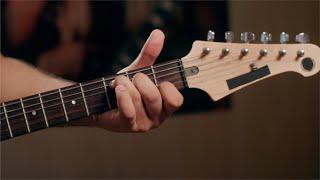 Closeup shot of hand movement of a guitarist playing guitar