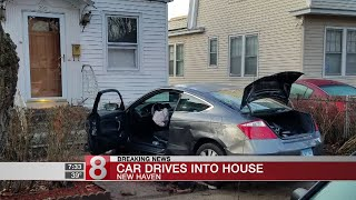 Car drives into New Haven house