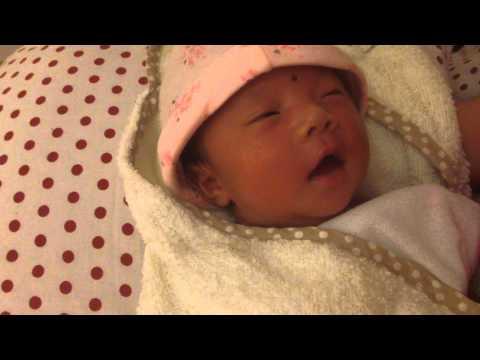 Newborn Baby Smiling While Sleeping