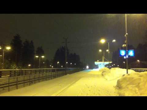 [VR] class Sr 1 electric locomotive pulling class Dr 14 diesel towards Helsinki past Hiekkaharju...