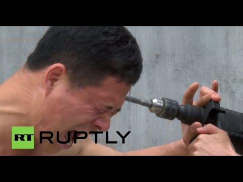 China: ELECTRIC DRILL no match for this Shaolin Kung Fu Master!