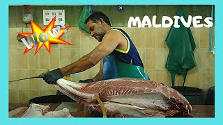 Cleaning A 50kg Tuna At The Fish Market In Malé, The Maldives