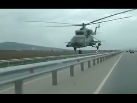 Get low, Chechnya style: Helicopter flies mere meters above highway (of course it's a dashcam!)