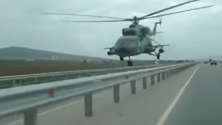 Get low, Chechnya style  Helicopter flies mere meters above highway (of course it's a dashcam!)