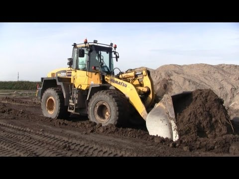 Komatsu WA320 Wheelloader Working Hard Pushing Dirt @ The Harbor