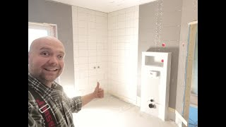 Completing bathroom wall tiles and the attic storage room at #jarleifhouse!