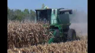John Deere 9410 Combine Picking and Unloading Corn