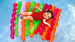 Sami and Amira plays with giant inflatable