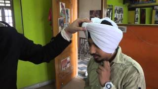 BHUPINDER SINGH THIND (SMART TURBAN TYING ON ANOTHER HEAD) 9463115177