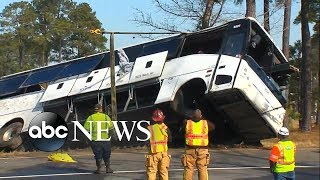 Two killed, dozens injured after charter bus rolls over on foggy interstate
