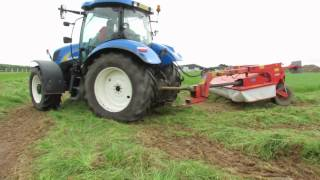 New Holland mowing grass