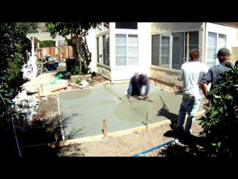 Pouring cement, backyard patio