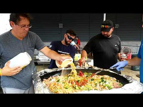 Paella in the works at World Central Kitchen SJU - YouTube