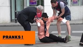 Old man falling over in public prank