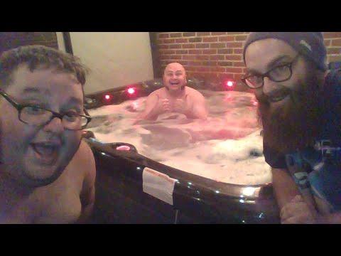 three dudes chillin in a hot tub