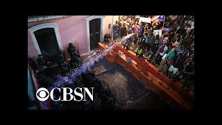Police and protesters clash in Puerto Rico as political crisis escalates