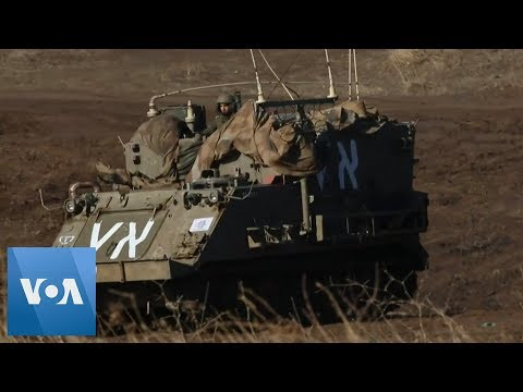 Israel's Military Vehicles Positioned in Golan Heights on Border With Syria