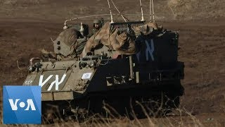 Gambar cover Israel's Military Vehicles Positioned in Golan Heights on Border With Syria
