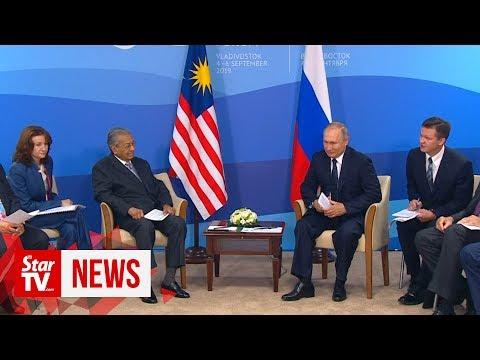 Mahathir, Putin hold