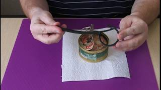 Открывалка для консервных банок с кольцами на крышке.