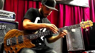 Miki Santamaria slapping a Wal bass with EBS amps