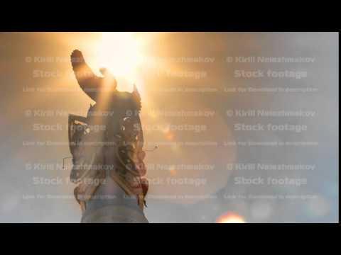 Sun passing over Stele monument Kazakh Eli with bird Samruk timelapse