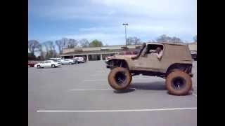 Jeep flips in parking lot!