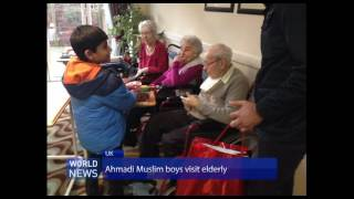 Ahmadi Muslim boys offer gifts to elderly during holiday season