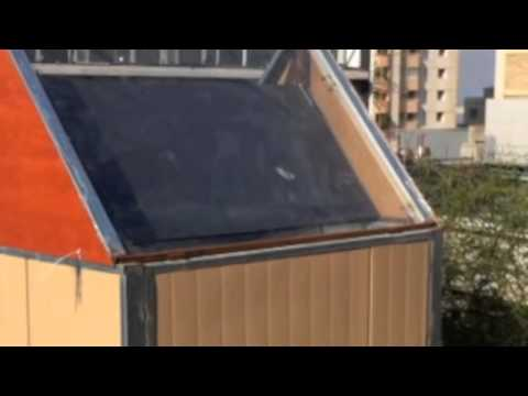Solar Chimneys for Passive Cooling in Buildings