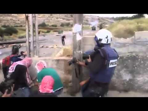 Palestinian terrorists hide behind journalists while firebombing Israeli soldiers