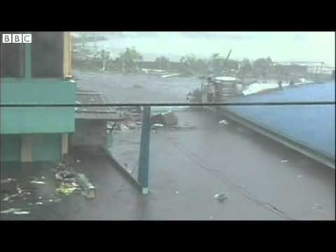 Typhoon Haiyan  Tacloban residents battle flood waters Travel Video