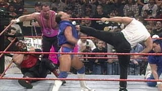 Steve Blackman runs in from the crowd to save Vader