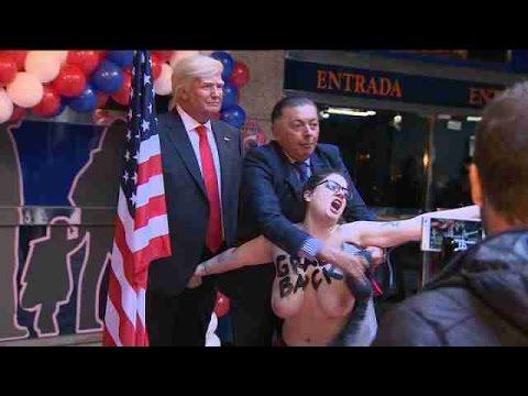 De topless, ativista do Femen invade inauguração de estátua de cera de Trump em Madri
