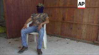 ONLY ON AP Drug cartel hitman on Mexico killings