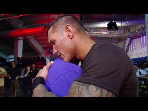 #PeaceDay: John Cena and Randy Orton share a hug backstage: Raw, November 22, 2010