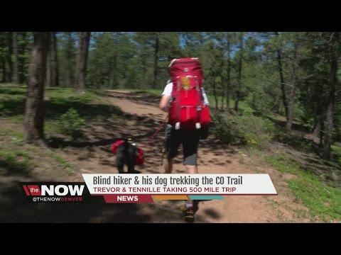 Blind hiker and  dog  taking a 500-mile trek